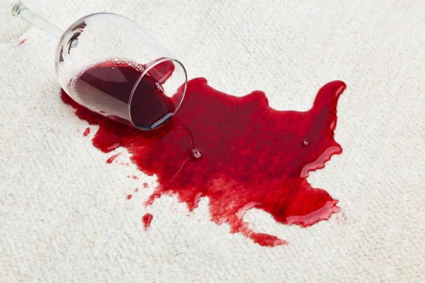 The first step to getting red wine out of your area rugs is to blot the area with a towel.